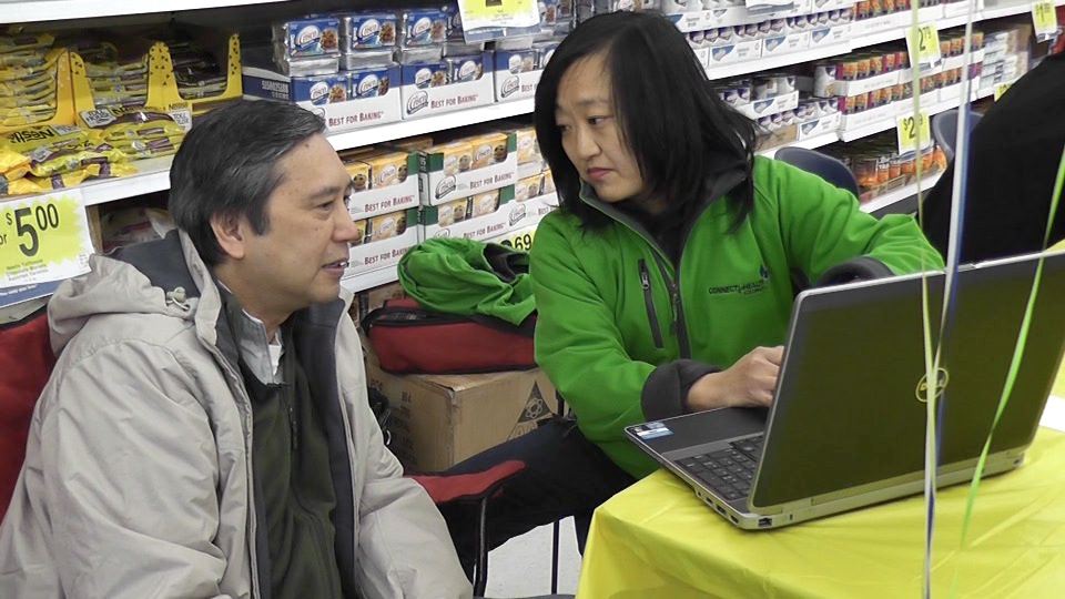 Exchange workers traveled to King Soopers stores around the state to help customers sign up for insurance.