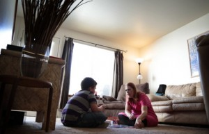 Danielle Nordeen  plays a board game with her son at their Grand Junction home. (Joe Mahoney/Rocky Mountain PBS I-News)