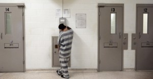 An inmate makes a phone call in Unit 4C of the Pueblo County  jail. (Joe Mahoney/Rocky Mountain PBS I-News)