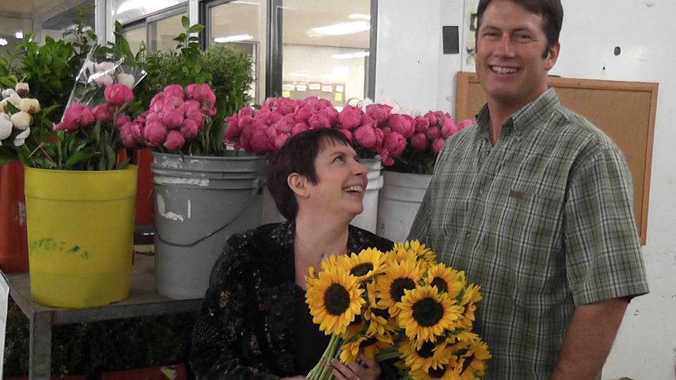 Denise and John Capelli have scaled back their wedding business, but still design floral arrangements after Denise survived a near-fatal medical ordeal.
