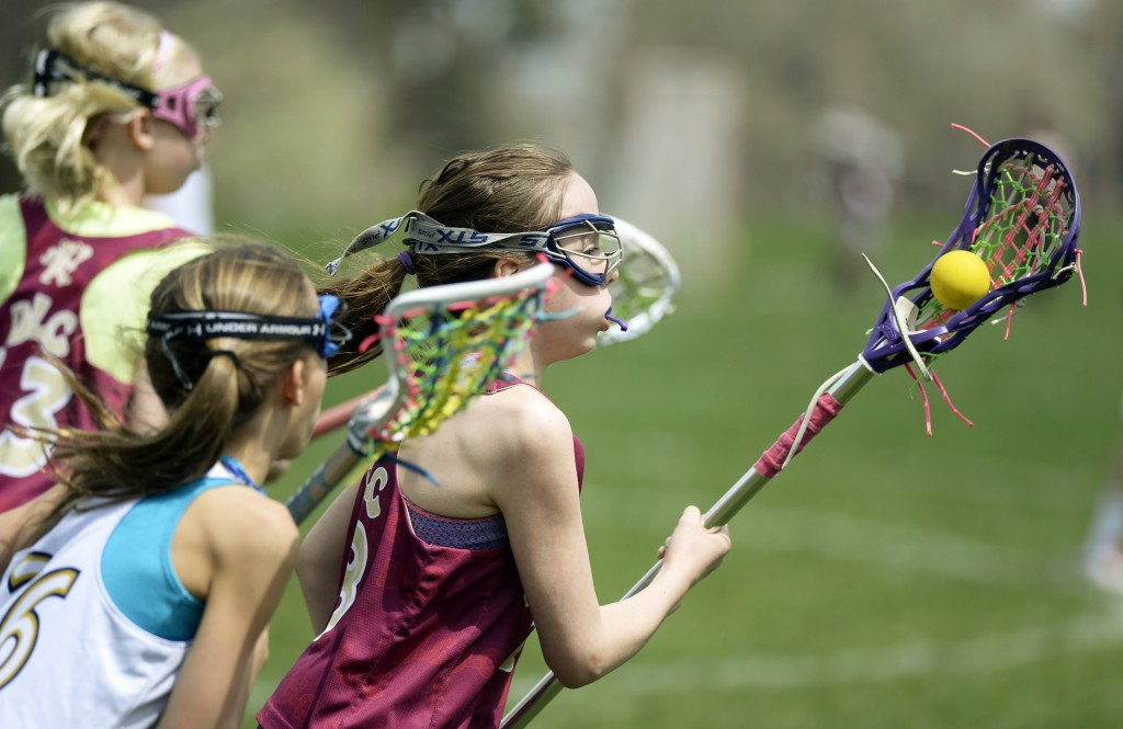 In girls' lacrosse, athletes don't wear helmets. A new study shows concussions in girls' lacrosse occur when a ball or stick hits a player's head. Helmets could prevent some concussions.