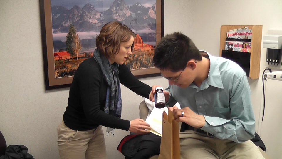 Care coordinator Sarah Bryson helps patient Roger Mondragon in Fort Collins. Bryson visits the doctor with Mondragon, who has complex health problems. to keep him on track and out of the hospital.