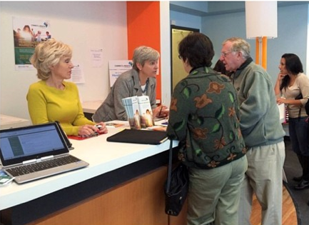 Exchange managers provide information about enrolling in health insurance at a 16th Street Mall store.