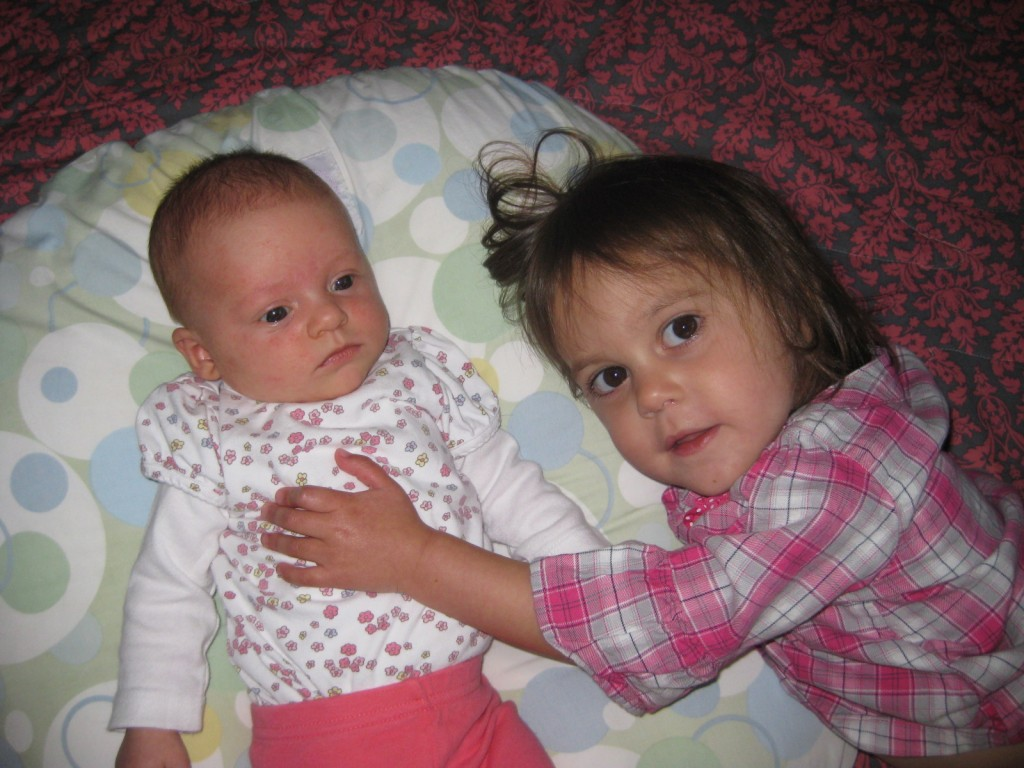 Adelyne, who was born at home in Steamboat Springs in 2012, with her sister, Emerald. (Photo courtesy of the Huron family.)