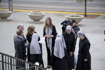 Members of the Little Sisters of the Poor gather in front of the federal courthouse in Denver