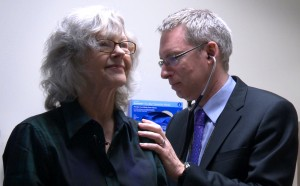 Polly Rogers, a lung cancer patient enrolled in a clinical trial, is checked by Dr. Ross Camidge, who leads the lung cancer trials at the University of Colorado Cancer Center.(Marcy MacCarthy/Special to Rocky Mountain PBS)