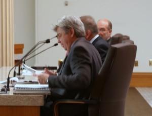 Interim CEO Gary Drews testifies to legislative oversight committee.