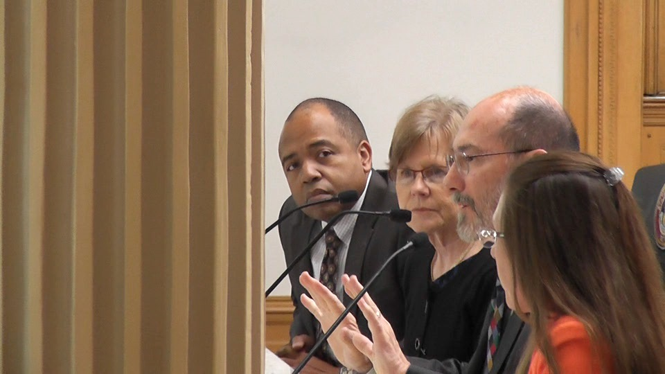 Incoming interim CEO Kevin Patterson, left, with board members, Sharon O'Hara and Steve ErkenBrack, testified before the Colorado legislative oversight committee on Wednesday.
