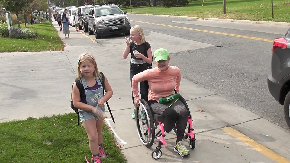 Jessica Peck picks up her girls from school. Despite her illness, she's trying to do it all, never taking a sick day and continuing to be the mom who takes her kids to soccer, dance and cotillion.